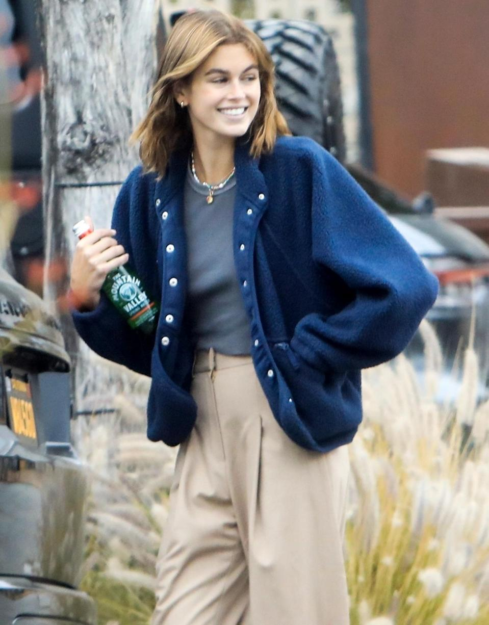 <p>Kaia Gerber wears khakis and a blue coat while out in West Hollywood on Thursday.</p>