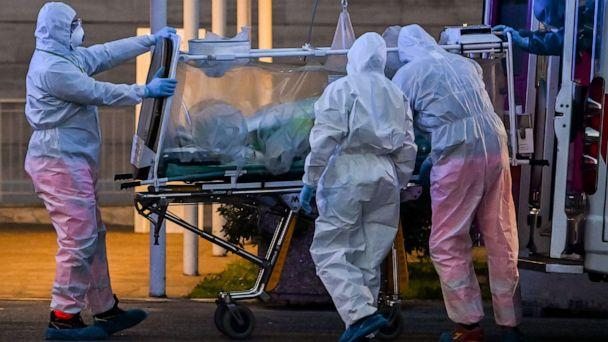 PHOTO: Medical workers move a patient under intensive care into the newly built Columbus Covid 2 temporary hospital to fight the new coronavirus infection, on March 16, 2020 at the Gemelli hospital in Rome. (Andreas Solaro/AFP via Getty Images)