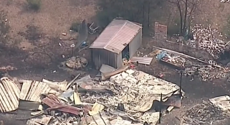 An aerial view of Bill Morris's home, which has been destroyed by a bushfire, near Wollemi National Park.