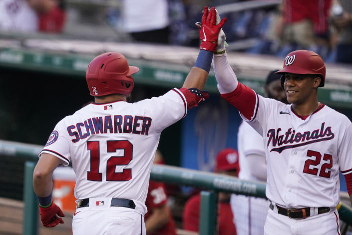 Washington Nationals' Kyle Schwarber celebrates his solo home run with Juan Soto during the first inning of a baseball game against the Tampa Bay Rays, at Nationals Park, Tuesday, June 29, 2021, in Washington. (AP Photo/Alex Brandon)