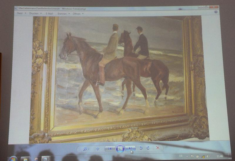 "A painting from Max Liebermann ""Zwei Reiter am Strande"" (""Two riders on the beach"") is projected on a screen during a news conference in Augsburg, southern Germany, Tuesday, Nov.5, 2013, on the art found in Munich. A hoard of more than 1,400 art works found last year at a Munich apartment includes previously unknown pieces by artists including Marc Chagall, German investigators said Tuesday, adding that they face a hugely complicated task to establish where the art came from. (AP Photo/Kerstin Joensson)"