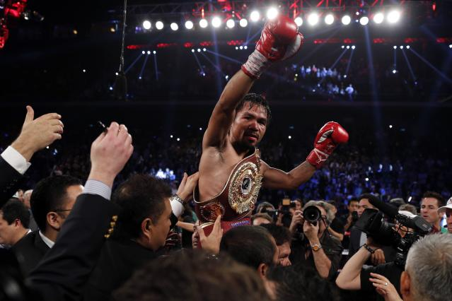 Manny Pacquiao of the Philippines celebrates his victory over Brandon Rios of the U.S. during their World Boxing Organisation (WBO) International 12-round welterweight boxing title fight at the Venetian Macao hotel in Macau November 24, 2013. Pacquiao registered a decisive, unanimous decision win against American Brandon Rios to clinch the vacant WBO International welterweight title on Sunday. REUTERS/Tyrone Siu (CHINA - Tags: SPORT BOXING)