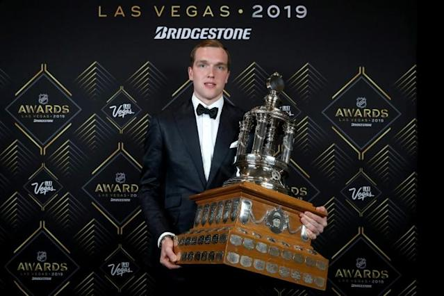 Russia's Andrei Vasilevskiy, posing with the Vezina Trophy as the NHL's top goaltender, signed an eight-year contract extension worth $76 million Monday with the Tampa Bay Lightning (AFP Photo/BRUCE BENNETT)