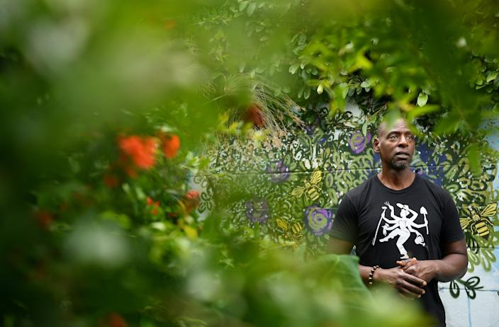 "Ron Finley, the Gangsta Gardener, stands among fruit trees in his garden where he's been running the Ron Finley Project in Los Angeles. <span class=""copyright"">(Wally Skalij / Los Angeles Times)</span>"
