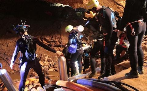 A group of Thai Navy divers in Tham Luang cave during rescue operations - Credit: AFP