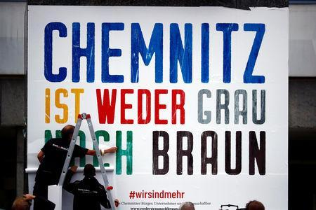 "Locals attach a banner reading ""Chemnitz is neither grey nor brown"" on the Karl Marx monument in Chemnitz, Germany September 1, 2018. REUTERS/Hannibal Hanschke"