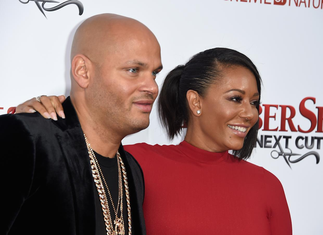 "HOLLYWOOD, CALIFORNIA - APRIL 06:  Stephen Belafonte and actress/musician Melanie Brown attend the  Premiere Of New Line Cinema's ""Barbershop: The Next Cut"" at TCL Chinese Theatre on April 6, 2016 in Hollywood, California.  (Photo by Frazer Harrison/Getty Images)"
