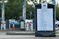 The government insists there is enough fuel in reserve but not enough tanker drivers to deliver it (AFP/Ben STANSALL)