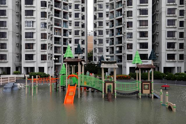 <p>A flooded playground is seen after Typhoon Hato hits Hong Kong, China, Aug. 23, 2017. (Photo: Tyrone Siu/Reuters) </p>