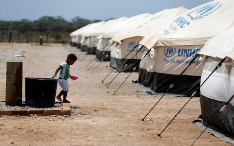 Three million Venezuelans have fled the country, the UN says, including to this refugee camp in Maicao, Colombia - Credit: Luiza Gonzalez/Reuters