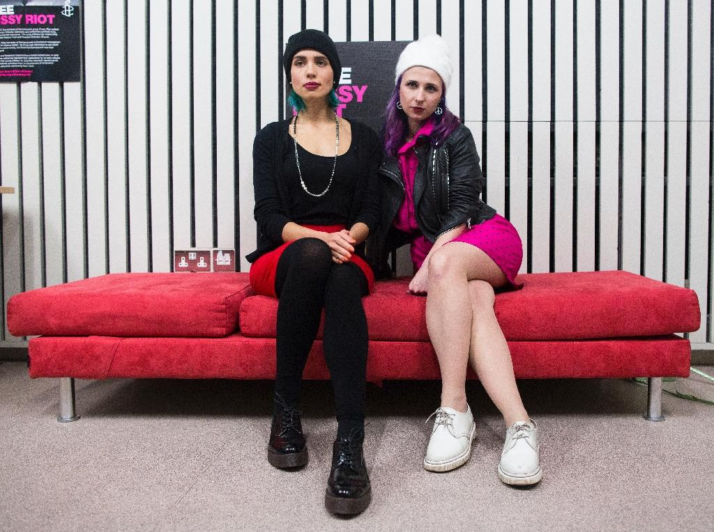 Nadezhda Tolokonnikova (L) and Maria Alekhina, members of the Russian punk rock band Pussy Riot, pose for photographs in East London on November 14, 2014 (AFP Photo/Andrew Cowie)