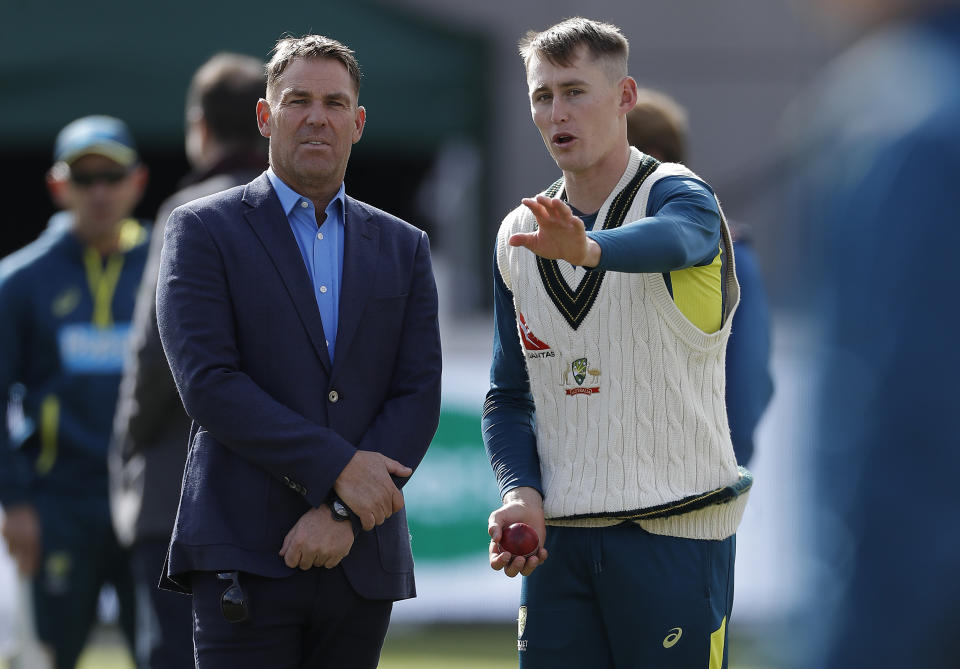 Shane Warne (pictured left) works with Marnus Labuschagne (pictured right)  on his bowling during day two of the 4th Specsavers Test between England and Australia at Old Trafford on September 05, 2019 in Manchester, England.