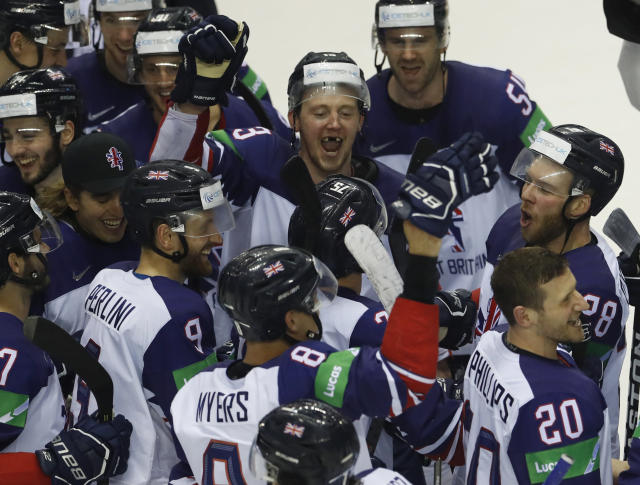 Players of Great Britain celebrate after winning the Ice Hockey World Championships group A match between France and Great Britain at the Steel Arena in Kosice, Slovakia, Monday, May 20, 2019. (AP Photo/Petr David Josek)