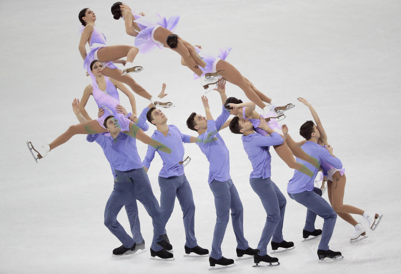 <p>In this multiple exposure image Natalia Zabiiako and Alexander Enbert of the Olmpic Athletes of Russia perform in the pair figure skating short program in the Gangneung Ice Arena at the 2018 Winter Olympics in Gangneung, South Korea, Wednesday, Feb. 14, 2018. (AP Photo/Julie Jacobson) </p>
