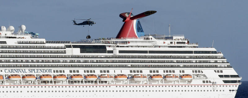 FILE - In this Nov. 9, 2010, file photo, a Navy Seahawk helicopter prepares to drop supplies onto the Carnival Splendor cruise ship during relief efforts in waters off Mexico's Baja Peninsula, seen from the USS Ronald Reagan aircraft carrier. Cruise operators, like airline pilots, may be relying too heavily on electronics to navigate massive ships, losing the knowledge and ability needed to operate a vessel in the case of a power failure, an expert sea pilot told a federal agency on Wednesday. (AP Photo/Gregory Bull, File)