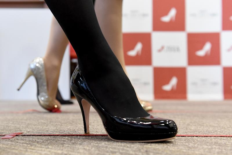 a37cb7f0bac High heels 'necessary', Japan minister says after petition