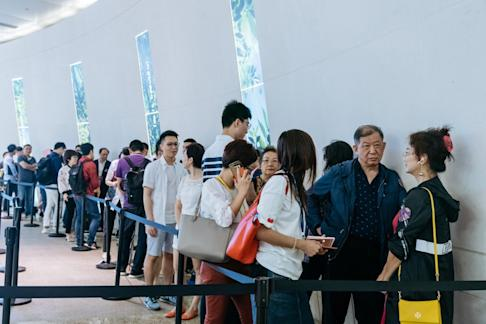 Buyers waiting in line at the sales office for the Victoria Harbour residential project by Sun Hung Kai Properties in Hong Kong on Sunday, July 15, 2018. Hong Kong property developers have increased the number of homes offered for sale after Chief Executive Carrie Lam imposed a vacancy tax. Photo: Bloomberg
