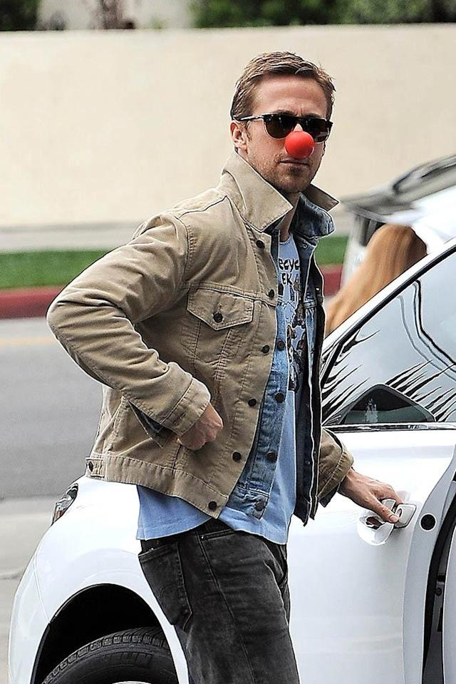 <p>So did Ryan Gosling, who somehow still managed to look cool while sporting a bright red honker. But, hey, it was for a good cause. Red Nose Day aims to end child poverty by raising money and awareness regarding kids in the U.S. and around the world. (Photo: BackGrid) </p>