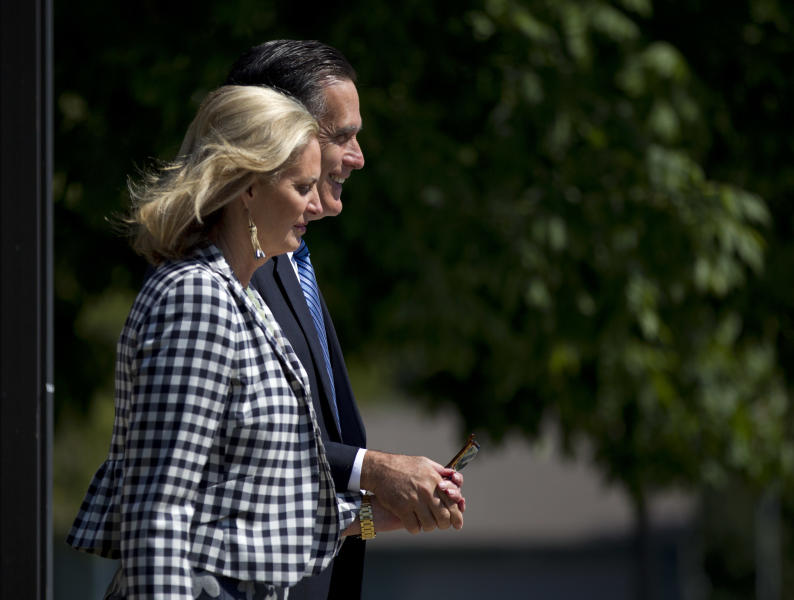 Republican presidential candidate and former Massachusetts Gov. Mitt Romney and his wife Ann leave the Church of Jesus Christ of Latter-day Saints after church service on Sunday, Aug. 26, 2012, in Wolfeboro, N.H. (AP Photo/Evan Vucci)