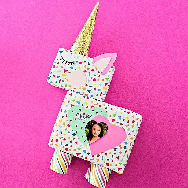 """<p>Use recycled materials to create this one-of-a-kind unicorn Valentine's box. Go an extra step and personalize with your child's photo.</p><p><strong>Get the tutorial at </strong><a href=""""https://www.hellowonderful.co/post/diy-unicorn-valentine-card-box/"""" rel=""""nofollow noopener"""" target=""""_blank"""" data-ylk=""""slk:Hello, Wonderful."""" class=""""link rapid-noclick-resp""""><strong>Hello, Wonderful. </strong></a></p><p><a class=""""link rapid-noclick-resp"""" href=""""https://www.amazon.com/s?k=card+stock&tag=syn-yahoo-20&ascsubtag=%5Bartid%7C2164.g.35119968%5Bsrc%7Cyahoo-us"""" rel=""""nofollow noopener"""" target=""""_blank"""" data-ylk=""""slk:SHOP CARD STOCK"""">SHOP CARD STOCK</a><br></p>"""