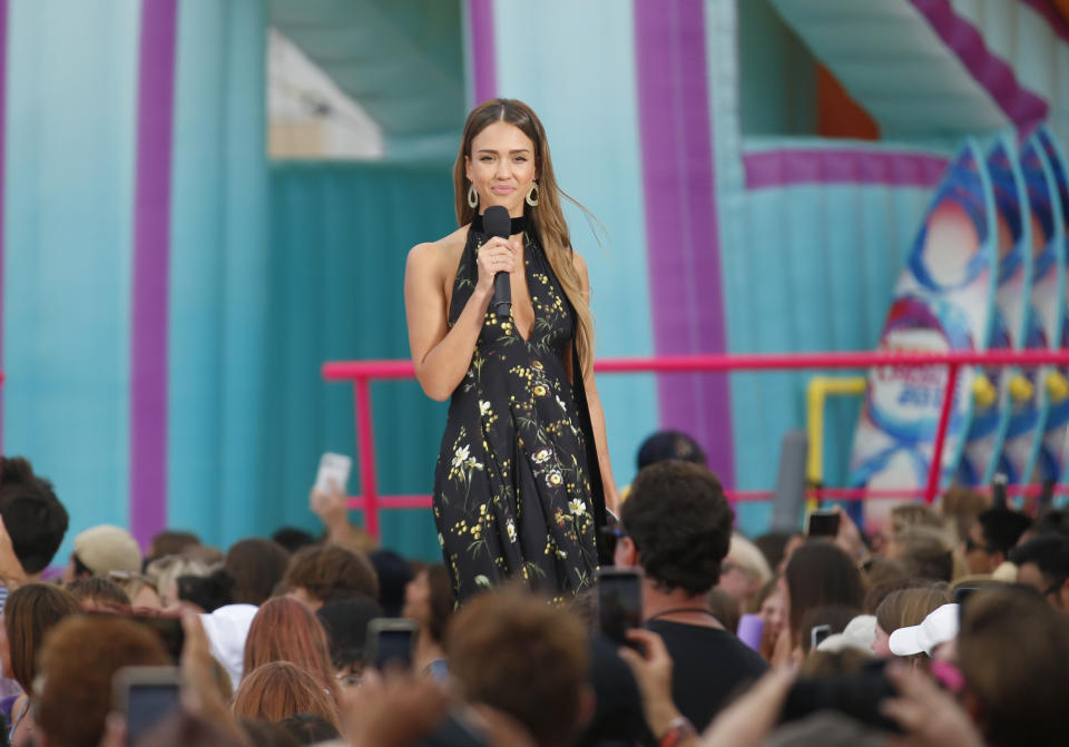 Jessica Alba presents the choice summer movie actress award at the Teen Choice Awards on Sunday, Aug. 11, 2019, in Hermosa Beach, Calif. (Photo by Danny Moloshok/Invision/AP)