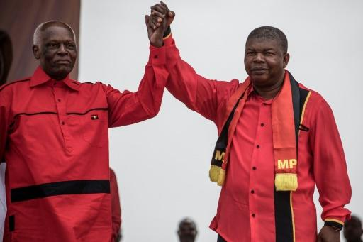 Happier times: Dos Santos and Lourenco, his hand-picked successor, at a rally in Luanda in August 2017