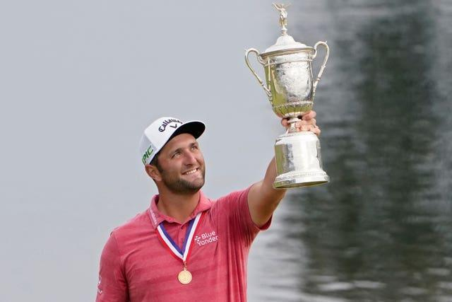 Jon Rahm, of Spain, holds the US Open champions trophy