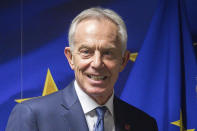 FILE - Former British Prime Minister Tony Blair is shown ahead of a meeting at the EU Charlemagne building in Brussels, in this Wednesday, Nov. 6, 2019, file photo. Hundreds of world leaders, powerful politicians, billionaires, celebrities, religious leaders and drug dealers have been stashing away their investments in mansions, exclusive beachfront property, yachts and other assets for the past quarter century, according to a review of nearly 12 million files obtained from 14 different firms located around the world. The report released Sunday, Oct. 3, 2021, by the International Consortium of Investigative Journalists involved 600 journalists from 150 media outlets in 117 countries. Former British Prime Minister Tony Blair is one of 330 current and former politicians identified as beneficiaries of the secret accounts. (Stephanie Lecocq/Pool via AP, File)