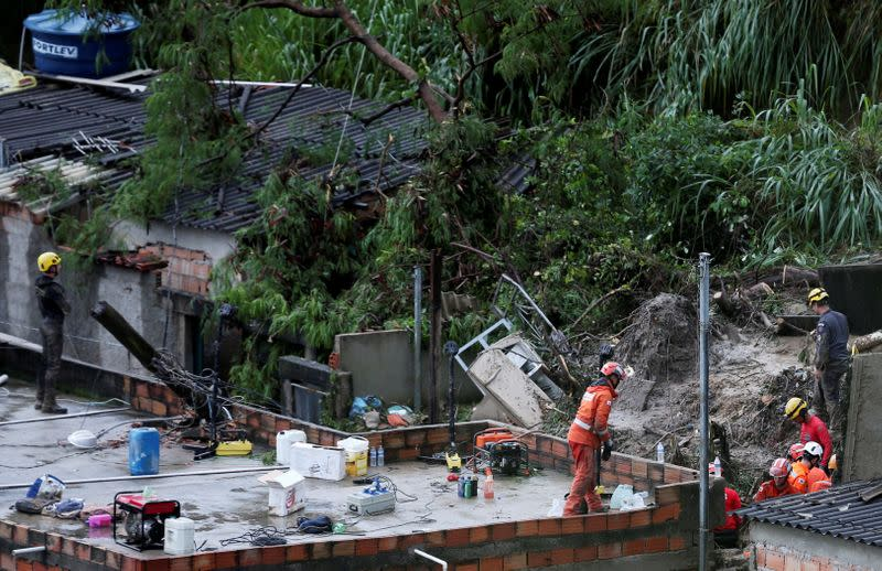 FILE PHOTO: Rescue workers search the site of a mudslide, after heavy rains at Vila Ideal neighborhood in Belo Horizonte