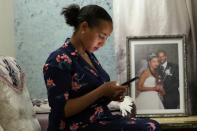 Hawi Desalegn, wife of Reuters cameraman Kumerra Gemechu, uses a cellphone at her house in Addis Ababa