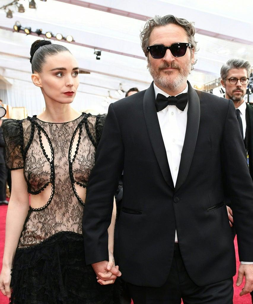 US actor Joaquin Phoenix arrives with Rooney Mara for the 92nd Oscars at the Dolby Theatre in Hollywood, California on February 9, 2020. (Photo by VALERIE MACON / AFP) (Photo by VALERIE MACON/AFP via Getty Images)