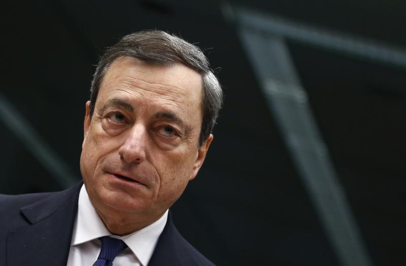 European Central Bank President Draghi looks on at the start of an Eurozone finance ministers meeting in Brussels