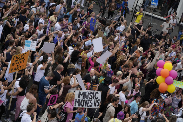 Thousands of fans of music festivals stage protests in Amsterdam, Netherlands, Saturday, Aug. 21, 2021, against the government's COVID-19 restrictions on large-scale outdoor events. On Saturday, the festivals came to music fans as hundreds of performers and festival organizers held demonstration marches through six Dutch cities to protest what they argue are unfair restrictions that have forced the cancellation of summer festivals and other events.(AP Photo/Peter Dejong)
