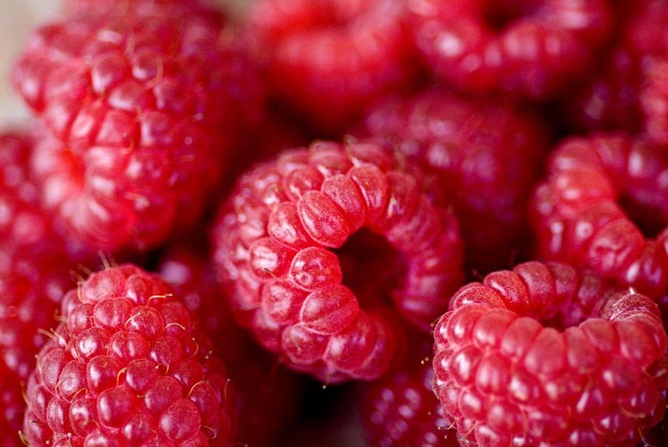 <p><strong>Just one cup of raspberries gives you a whopping 8 grams of fiber to help keep you fueled and satisfied. </strong>They're also high in several antioxidant compounds. Pair them with a handful of nuts for a protein boost.</p>