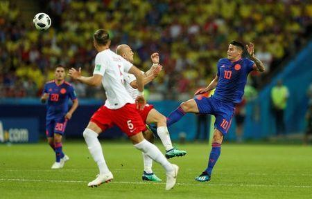Colombia's James Rodriguez in action with Poland's Michal Pazdan. REUTERS/John Sibley