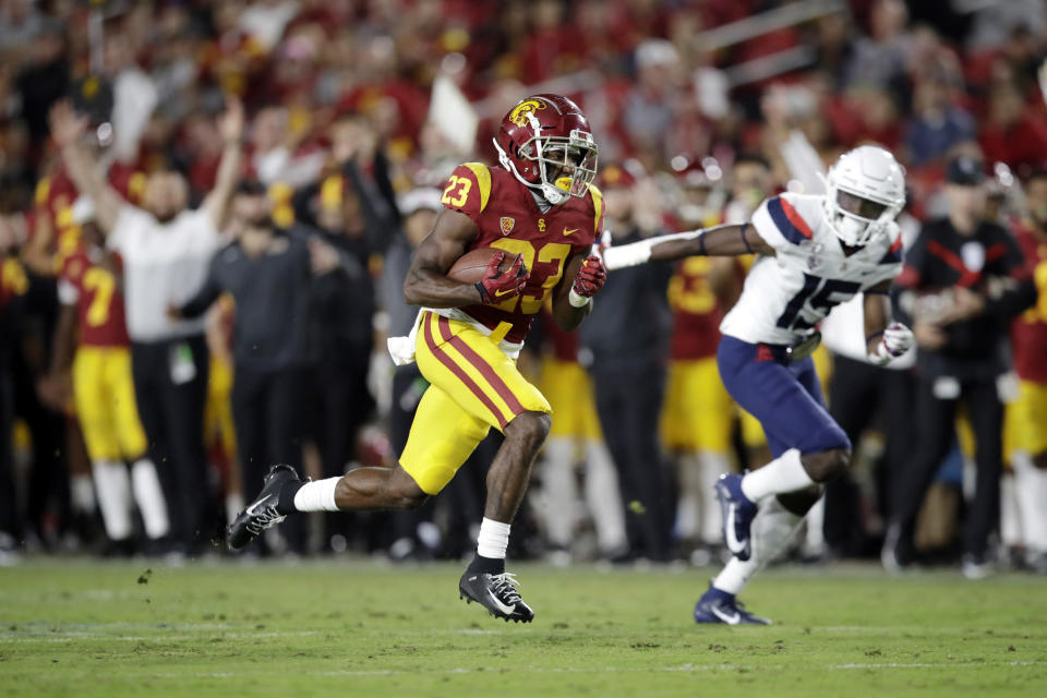 Southern California running back Kenan Christon (23) scores a rushing touchdown past Arizona cornerback McKenzie Barnes (15) during the second half of an NCAA college football game Saturday, Oct. 19, 2019, in Los Angeles. (AP Photo/Marcio Jose Sanchez)
