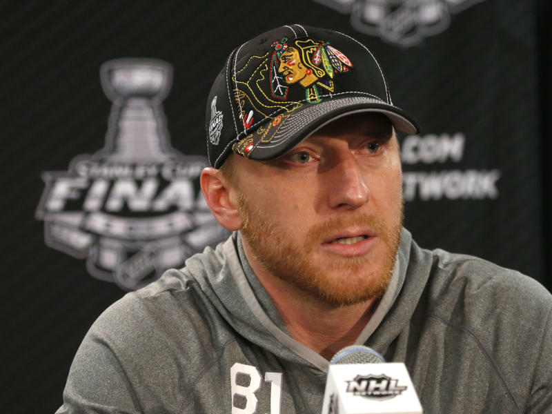Chicago Blackhawks right wing Marian Hossa responds to a question during an NHL Stanley Cup Final hockey series news conference Thursday, June 13, 2013 in Chicago. The Blackhawks lead the best-of-seven series 1-0 and will face the Boston Bruins in Game 2 on Saturday. (AP Photo/Charles Rex Arbogast)