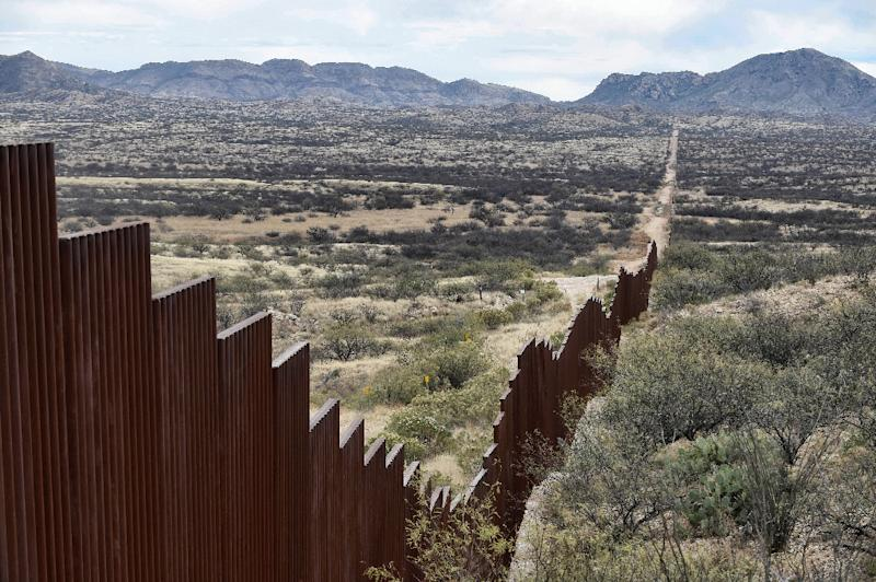 The 2,000-mile US-Mexico border is partially fenced, but the US President plans to build a wall to stop illegal immigrants from Latin America (AFP Photo/ALFREDO ESTRELLA)