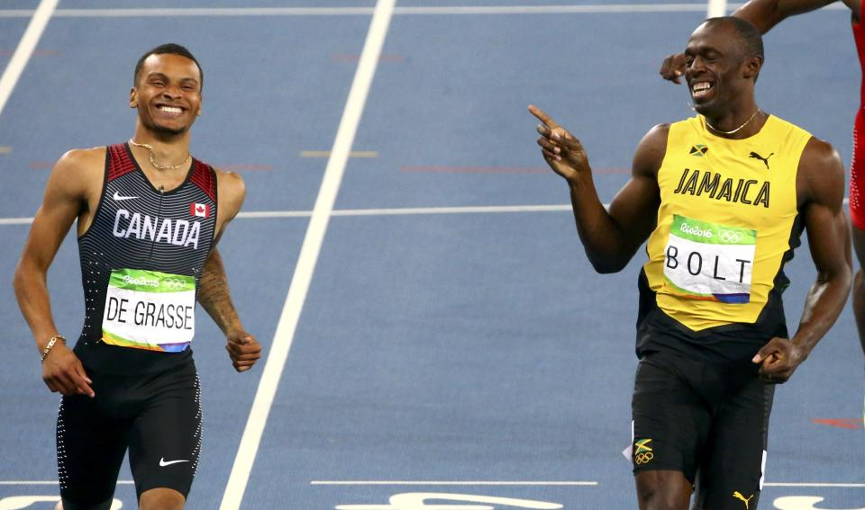 Usain Bolt and Andre De Grasse share a smile at the end of the 200m semifinal at the Rio 2016 Summer Olympics.