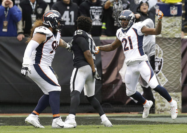 <p>Oakland Raiders wide receiver Michael Crabtree, center, fights with Denver Broncos nose tackle Domata Peko, left, and cornerback Aqib Talib during the first half of an NFL football game in Oakland, Calif., Sunday, Nov. 26, 2017. Crabtree and Talib were ejected. (AP Photo/Ben Margot) </p>