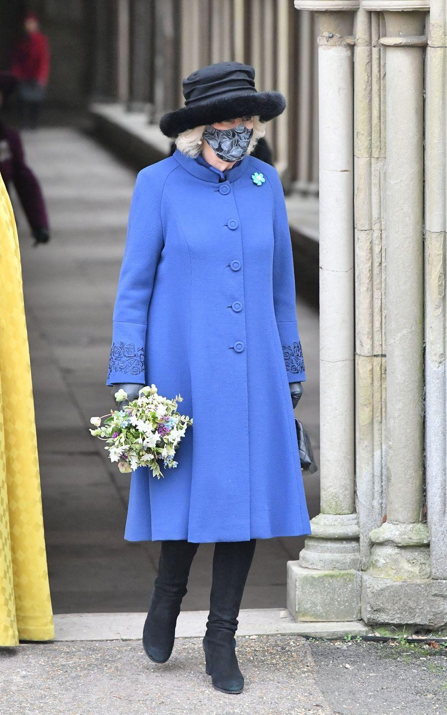 <p>The Duchess of Cornwall sported a blue coat with floral-embroidered cuffs, black boots, and a black fur-trimmed hat while attending a celebration of Salisbury Cathedral's 800th anniversary.</p>