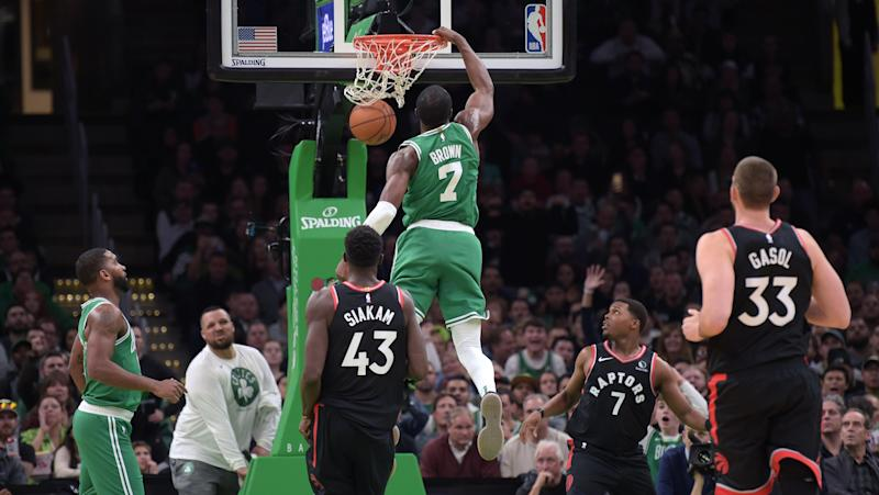 Oct 25, 2019; Boston, MA, USA; Boston Celtics guard Jaylen Brown (7) dunks the ball past Toronto Raptors forward Pascal Siakam (43) during the first half at TD Garden. Mandatory Credit: Bob DeChiara-USA TODAY Sports