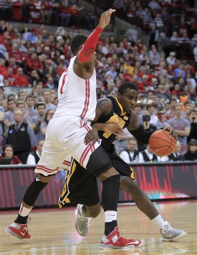 Iowa's Anthony Clemmons, right, drives to the basket against Ohio State's Deshaun Thomas during the first half of an NCAA college basketball game Tuesday, Jan. 22, 2013, in Columbus, Ohio. (AP Photo/Jay LaPrete)