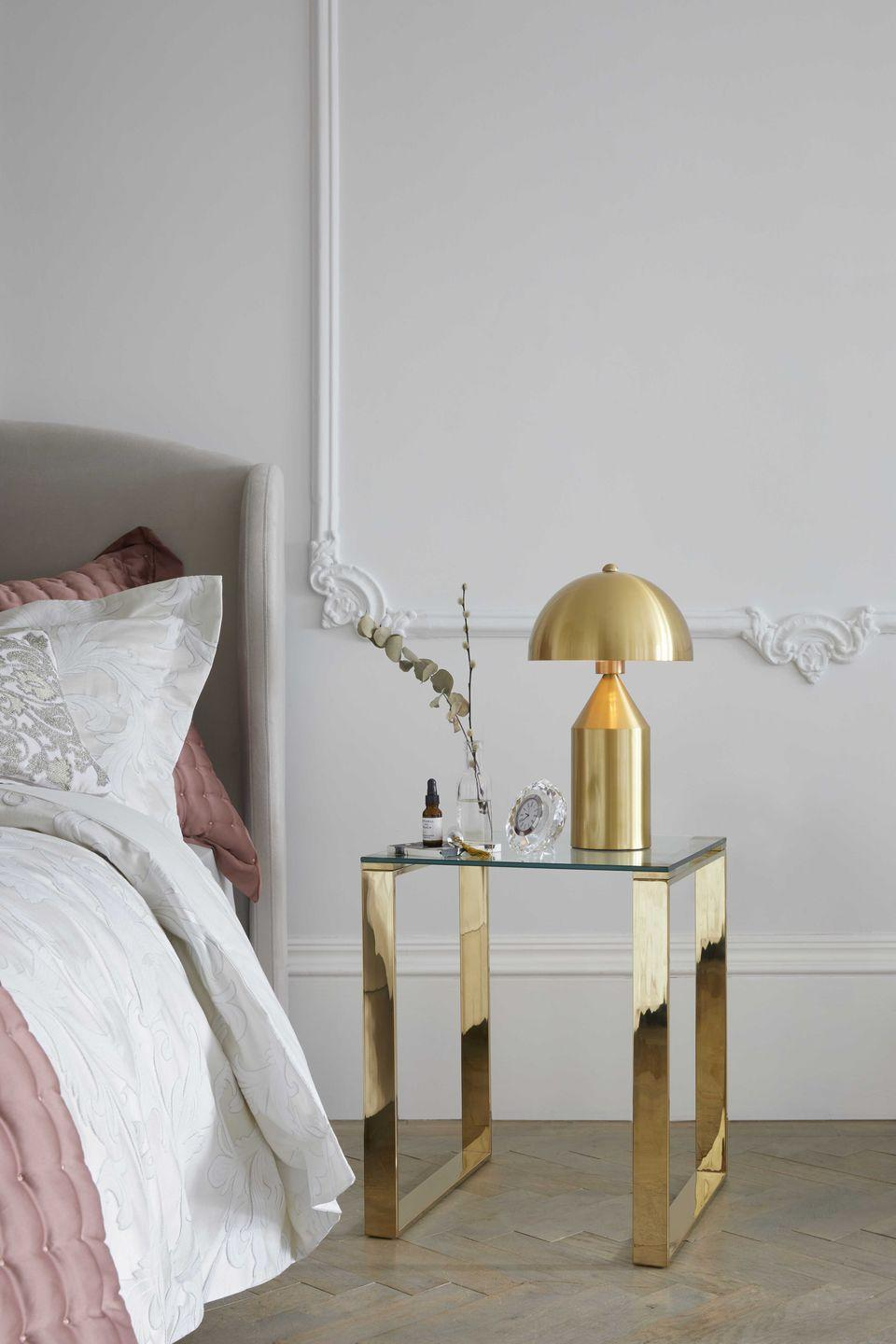 "<p><strong>Lighting — such as this gold one from Dunelm — is sure to give a reason for your followers to double-tap on your feed. </strong></p><p>When opting for bedroom lighting, don't be afraid to go bold. Placing one on your bedside cabinet will not only be practical when it comes to reading before bed, but it will help to transform your space. </p><p><strong>Pictured</strong>: <a href=""https://go.redirectingat.com?id=127X1599956&url=https%3A%2F%2Fwww.dunelm.com%2Fproduct%2Falbany-gold-table-lamp-1000110303&sref=https%3A%2F%2Fwww.housebeautiful.com%2Fuk%2Fdecorate%2Fbedroom%2Fg28786488%2Finstagram-bedroom%2F"" rel=""nofollow noopener"" target=""_blank"" data-ylk=""slk:Gold table lamp, £104, Dunelm"" class=""link rapid-noclick-resp"">Gold table lamp, £104, Dunelm</a> </p><p><a class=""link rapid-noclick-resp"" href=""https://go.redirectingat.com?id=127X1599956&url=https%3A%2F%2Fwww.dunelm.com%2Fproduct%2Falbany-gold-table-lamp-1000110303&sref=https%3A%2F%2Fwww.housebeautiful.com%2Fuk%2Fdecorate%2Fbedroom%2Fg28786488%2Finstagram-bedroom%2F"" rel=""nofollow noopener"" target=""_blank"" data-ylk=""slk:BUY NOW"">BUY NOW</a></p>"