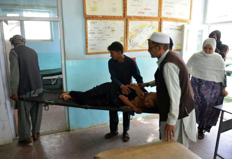 Afghan volunteers carry an injured woman on a stretcher to a hospital in Ghazni province earlier this week