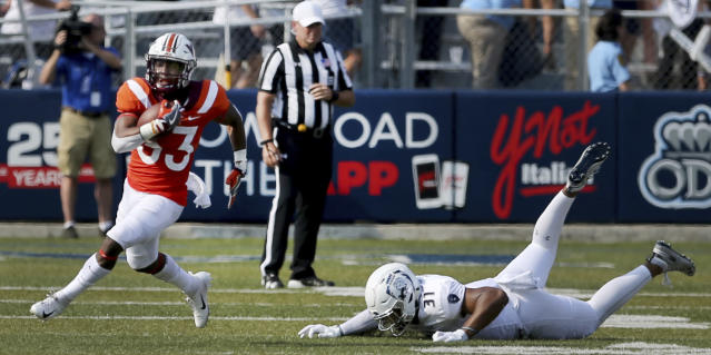 Virginia Tech's DeShawn McClease, left, breaks past Old Dominion's Sean Carter during the first half of an NCAA college football game Saturday, Sept. 22, 2018, in Norfolk, Va. (AP Photo/Jason Hirschfeld)