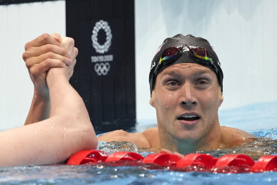 Caeleb Dressel of the United States celebrates winning the men's 100-meter freestyle final at the 2020 Summer Olympics, Thursday, July 29, 2021, in Tokyo, Japan. (AP Photo/Matthias Schrader)