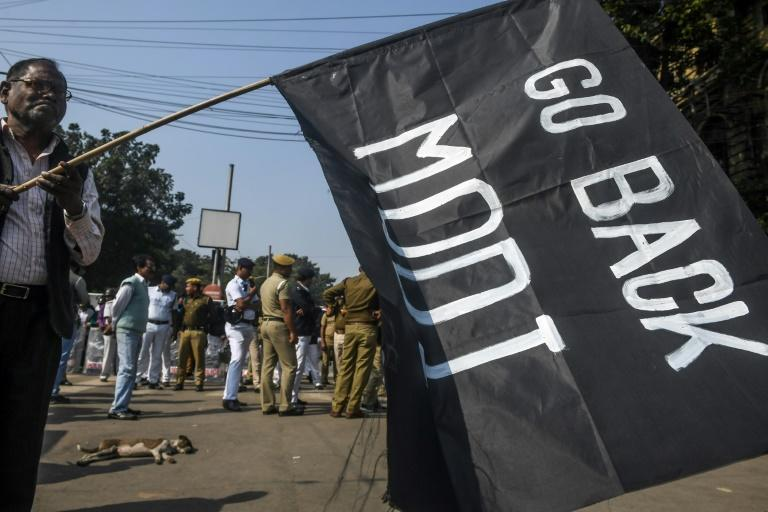 Protesters in Kolkata brandished black flags, considered an insulting gesture in Indian society