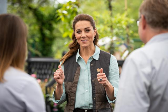 The Duchess of Cambridge talks to Martin and Jennie Turner, owners of the Fakenham Garden Centre in Norfolk, during her first public engagement since lockdown. (PA images)