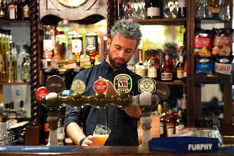 A bar tender is seen pouring a beer at the Glenferrie Pub in Melbourne.